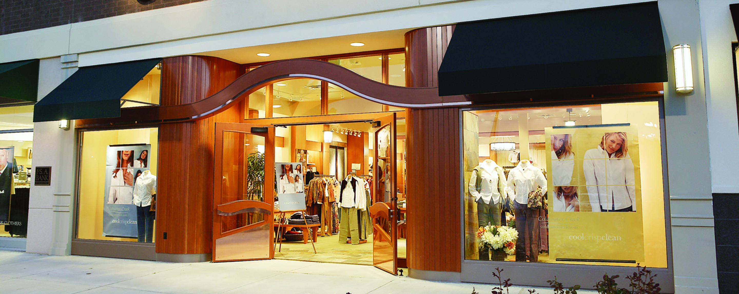 From the outside of Columbia Mall, you can see the open doors to a retail store with sample clothing and photos on display.