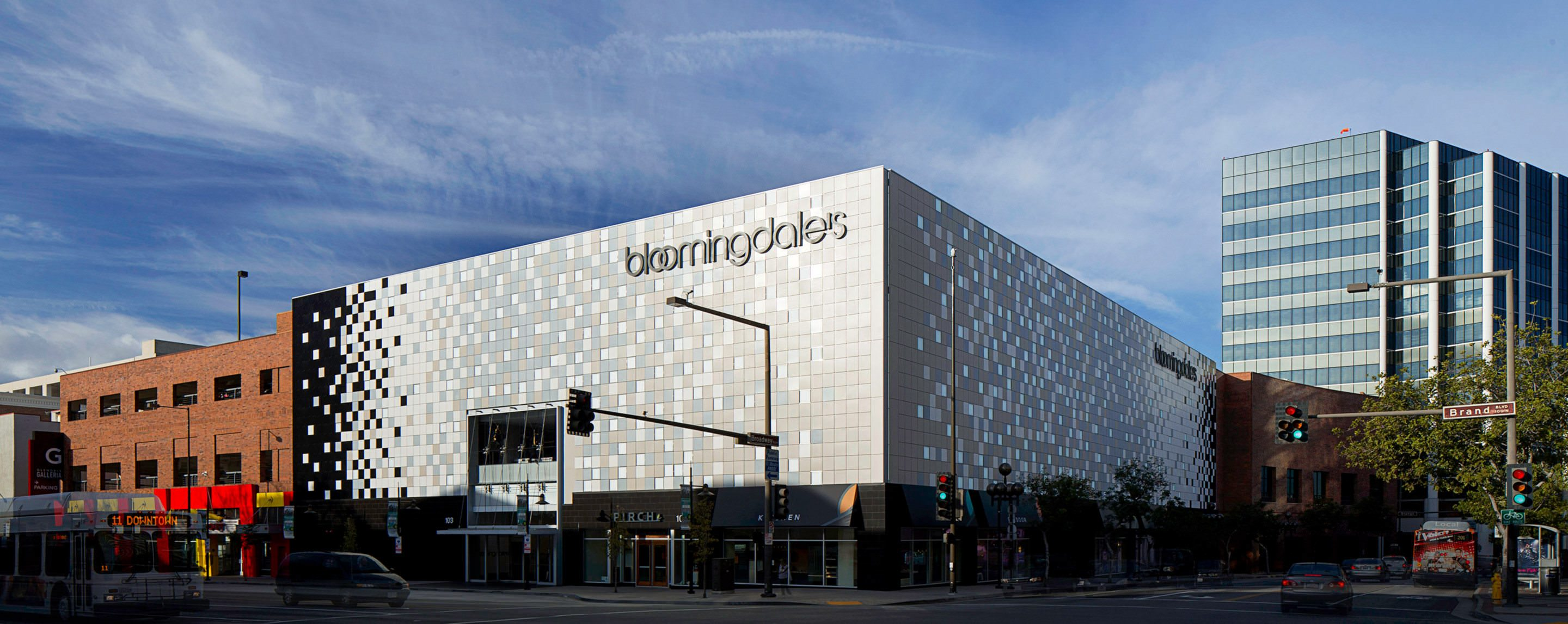 On a sunny day, the Bloomingdales outside of the Galleria Office Tower draws attention from cars passing by.