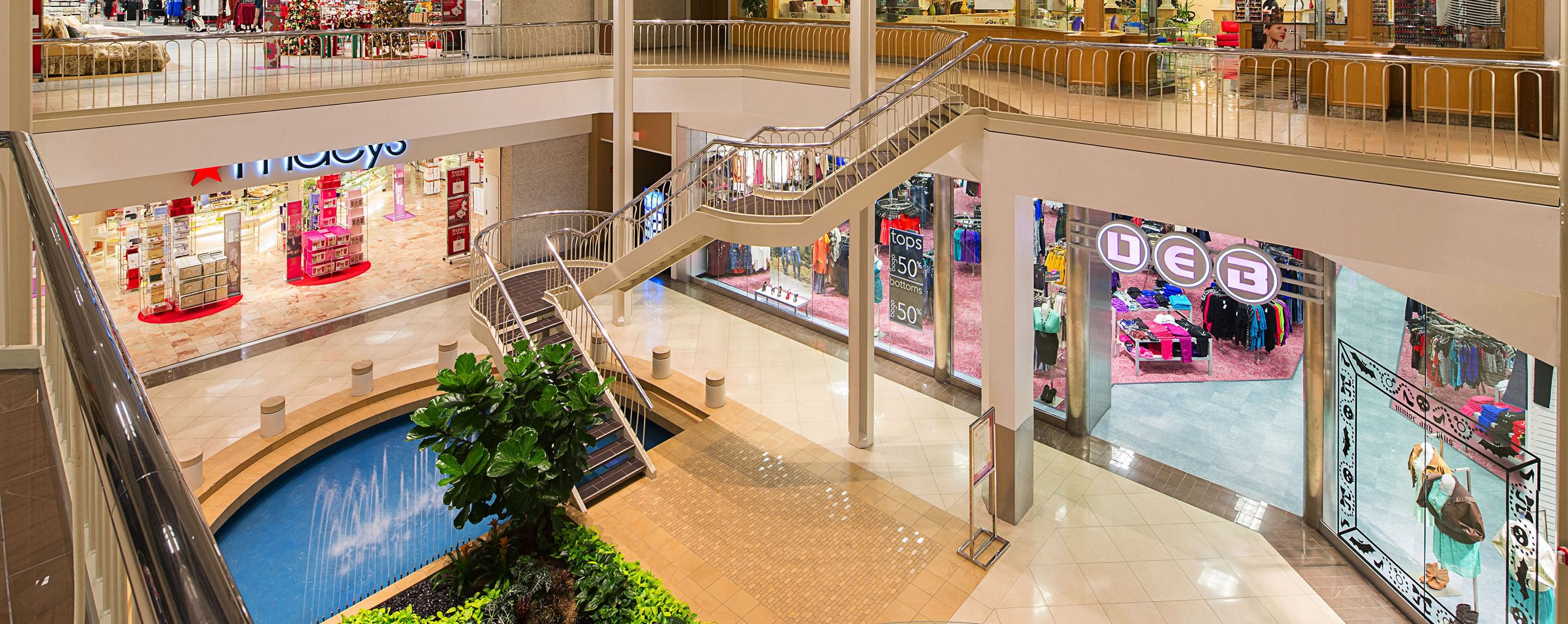 On the upper level of the Hulen Mall indoor atrium, shoppers can see the running fountain and greenery in the lower level.