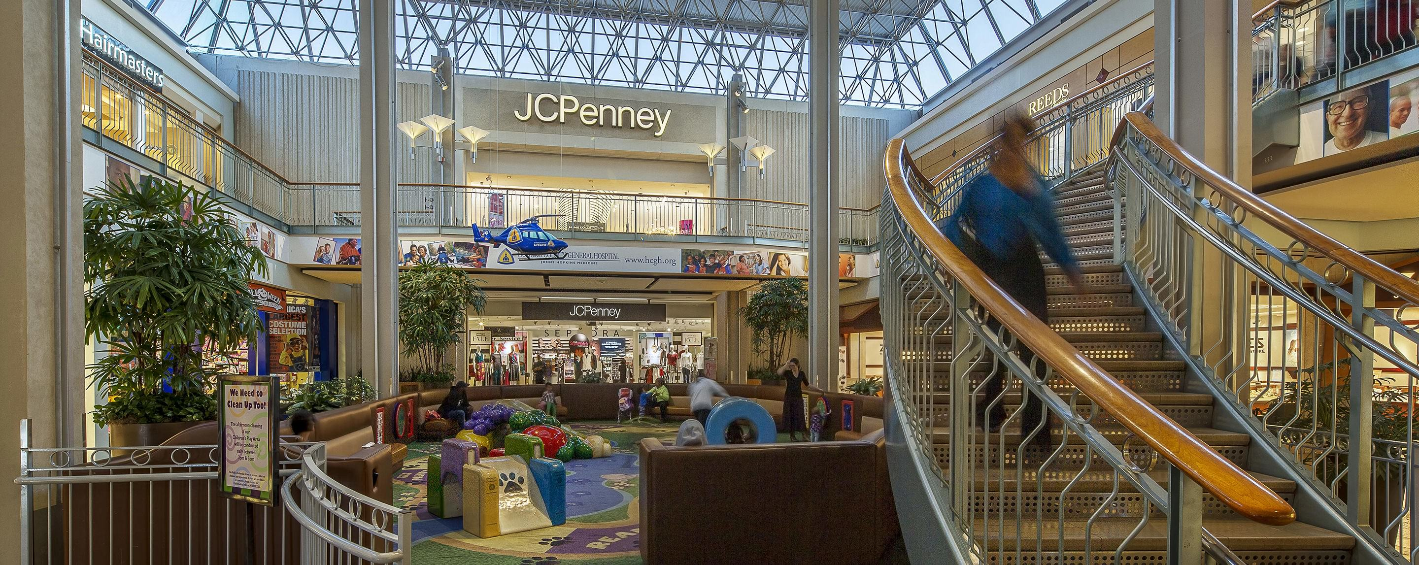 Children play in the play area in front of JCPenney at The Mall in Columbia.