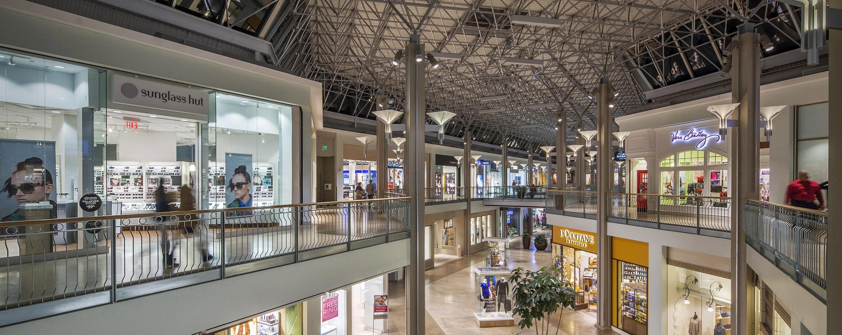 Shoppers walk along interior walkways alongside such stores as sunglass hut and Vera Bradley at The Mall in Columbia.