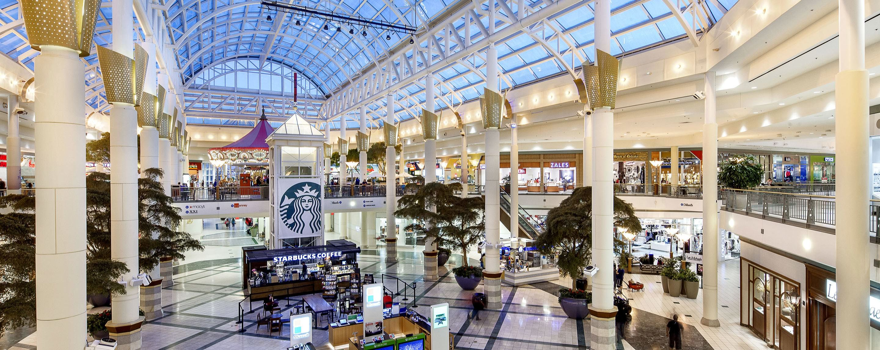 The second level of the indoor atrium at the Mall of Louisiana oversees a line of stores and a Starbucks kiosks.