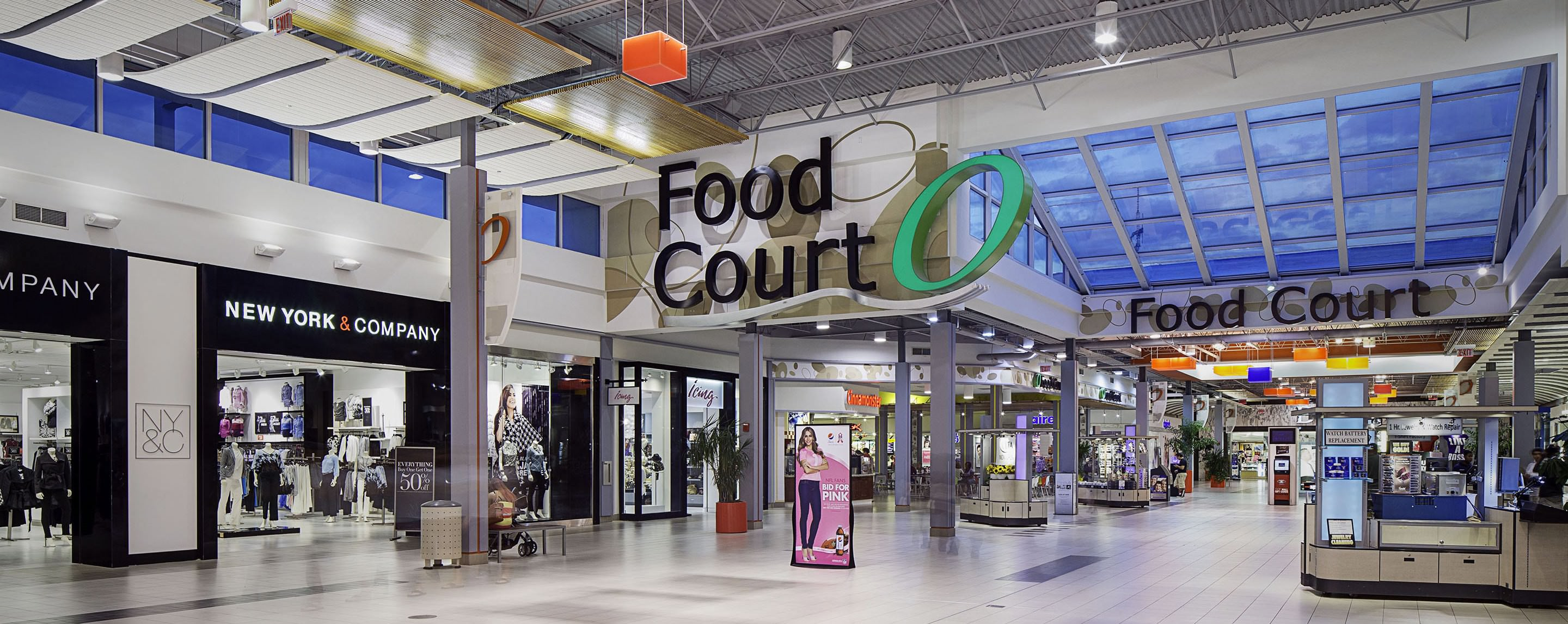 At night, the Oakwood Center sign shines bright over the mall's food court entrance