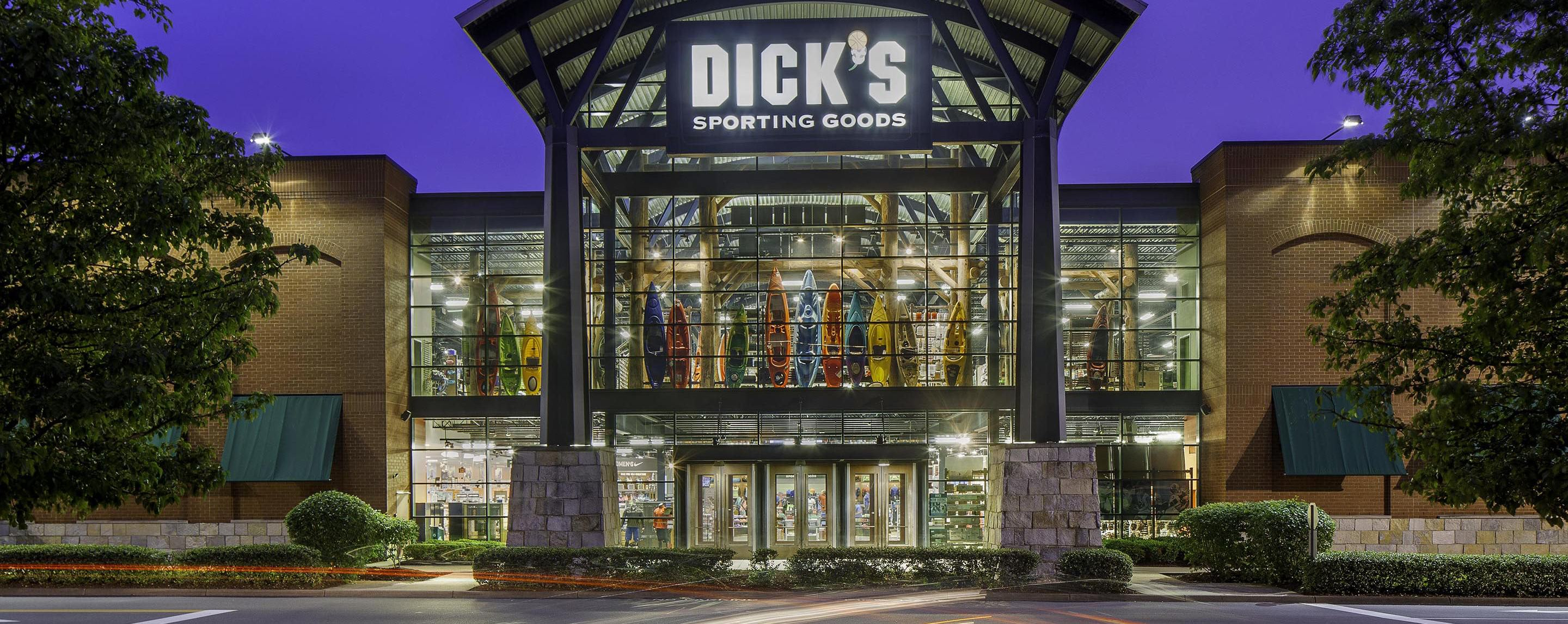 At Oxmoor Center, flowers and plants decorate the exterior entrance of Dick's Sporting Goods, which is illuminated at night from interior lights
