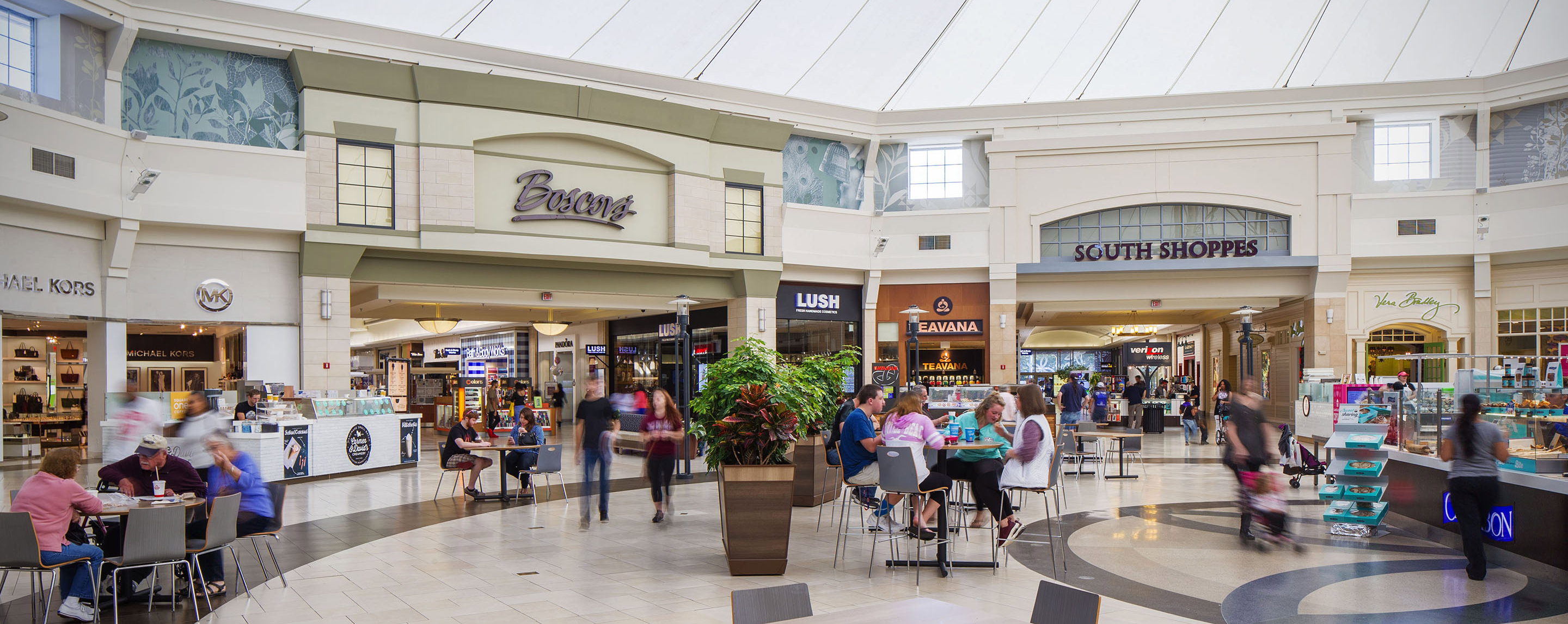 An indoor atrium at Park City Center offers numerous shoppers places it sit and relax.