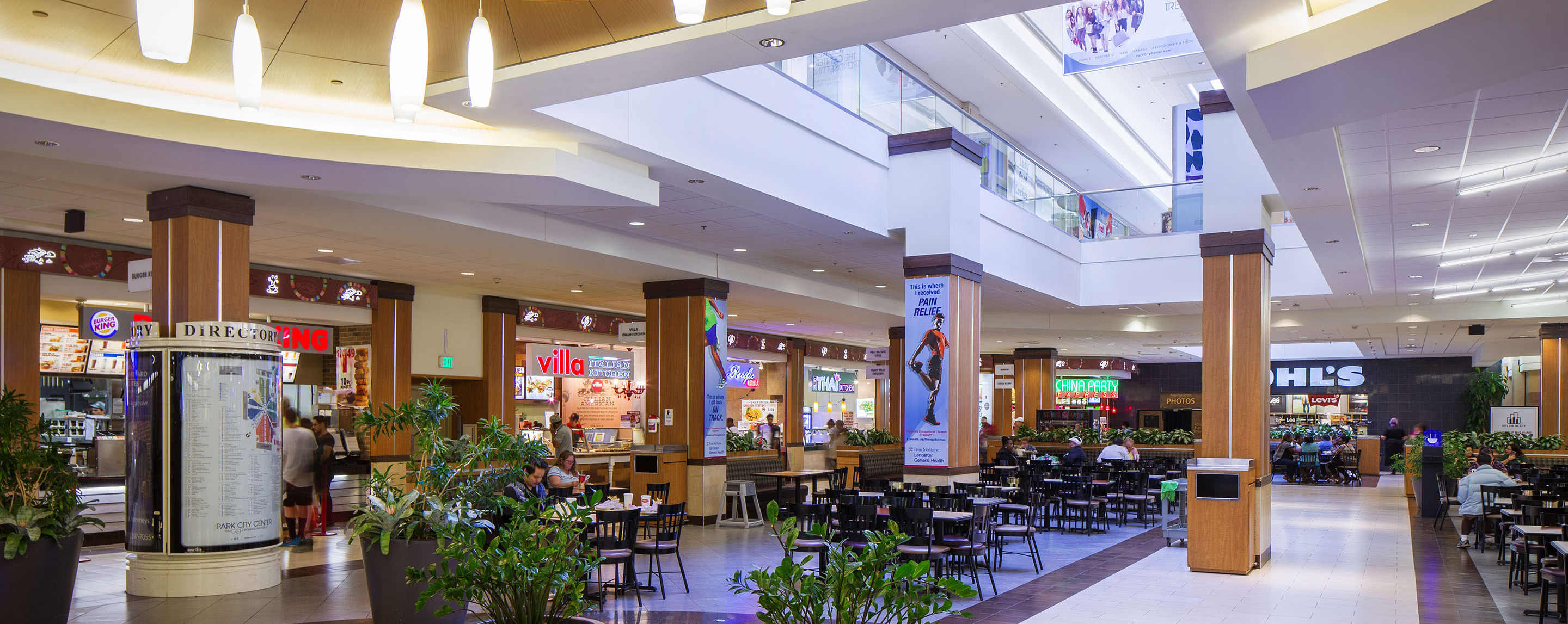 The Park City Center food court is filled with tables and chairs with a variety of dining options.