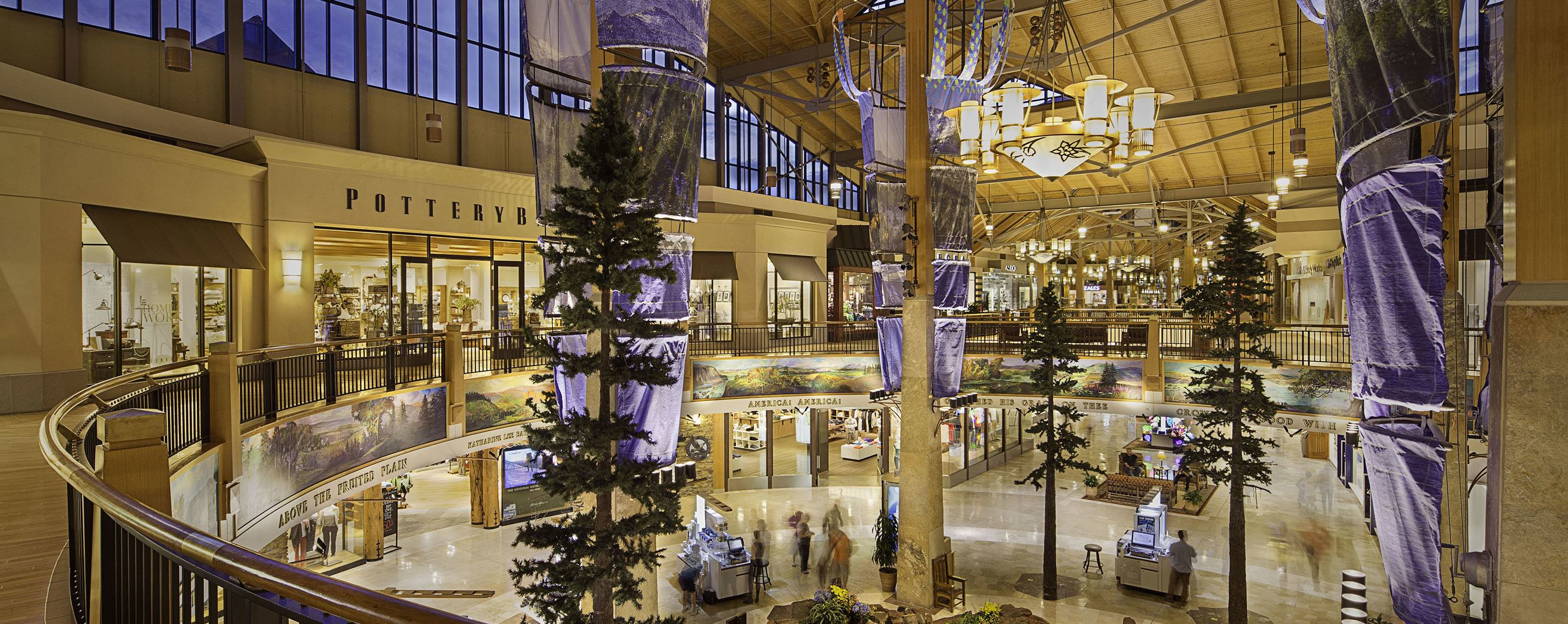 From the upper level overlooking the Park Meadows atrium, indoor pine trees are the main focus for shoppers.