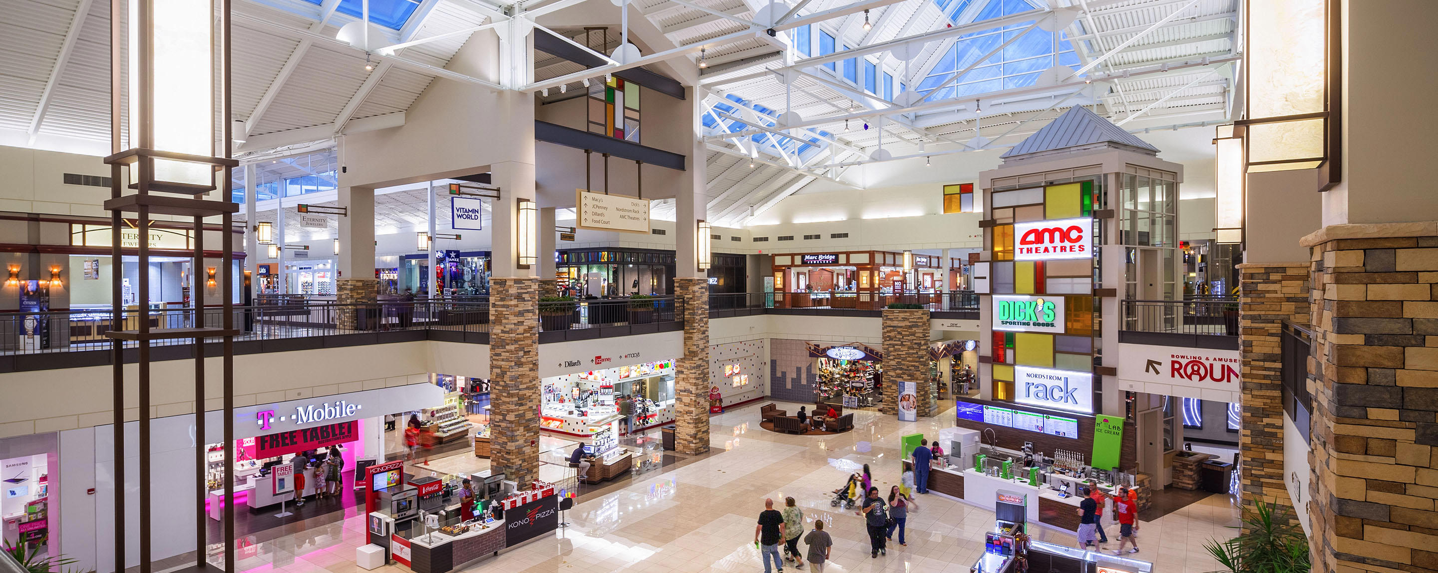 Inside The Parks Mall at Arlington, shoppers consider stores and entertainment options across two levels.