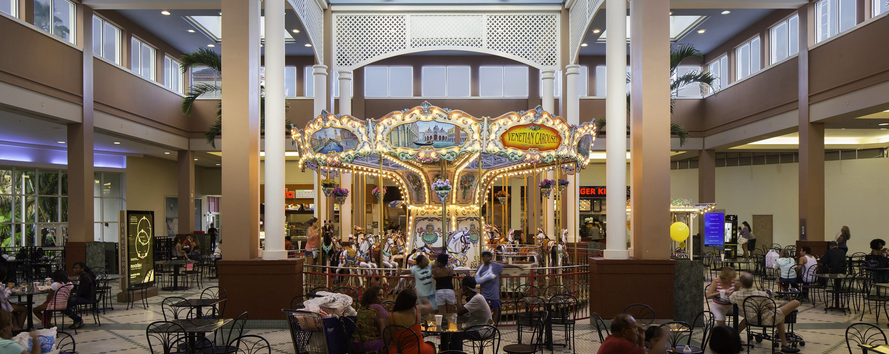 A carousel is seen in the Pembroke Lakes food court for guests to enjoy with their children.