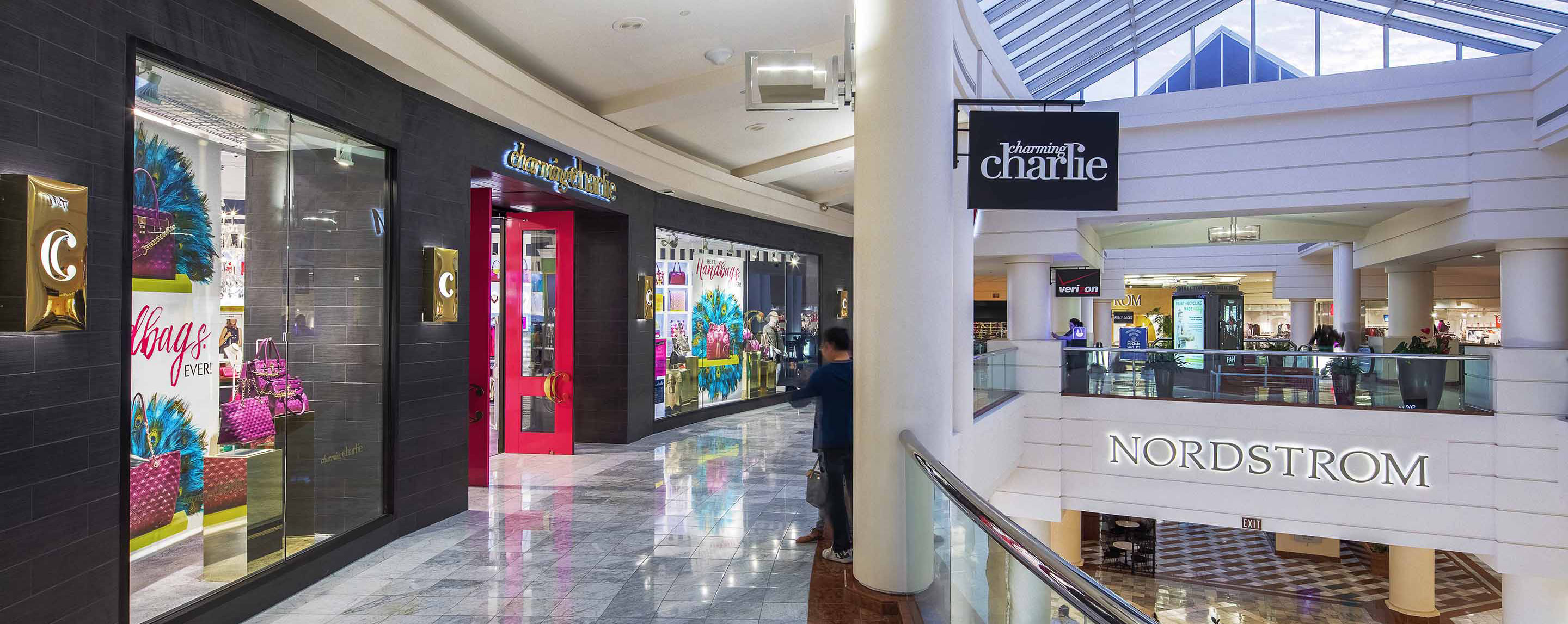 Shoppers stroll around such stores as Charming Charlie and Nordstrom on a sunny day at Stonestown Galleria.