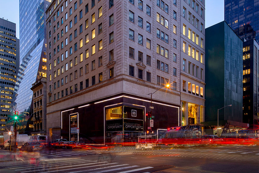 GGP's 685 Fifth Avenue property is lit up at dusk as traffic pass by the building