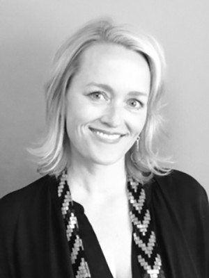 A black and white headshot of GGP VP of Premier Property Leasing, Kirsten Lee, smiling.