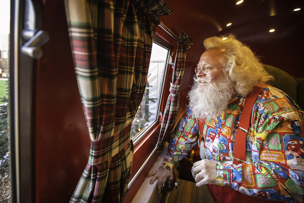Santa looks out of the window of his vintage Airstream