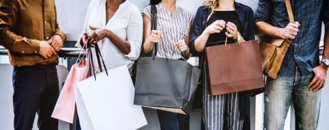 women hold shopping bags