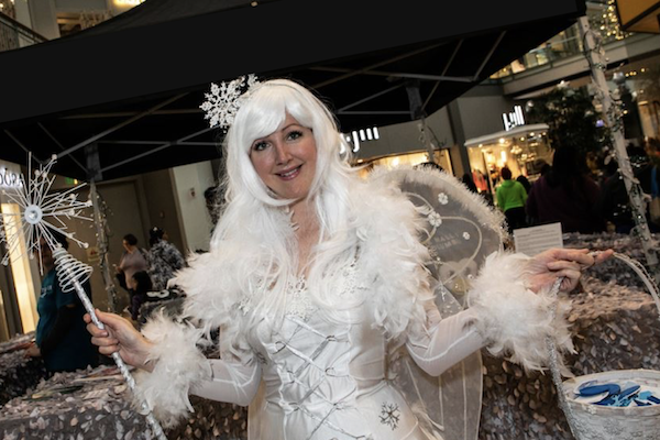 Woman dressed in white winter wonderland gear
