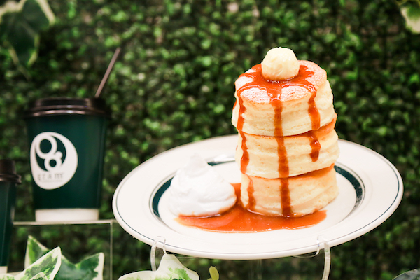 Stacked Japanese-style pancakes drizzled with syrup