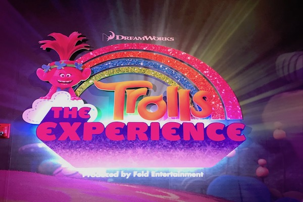 The Trolls Experience welcome sign