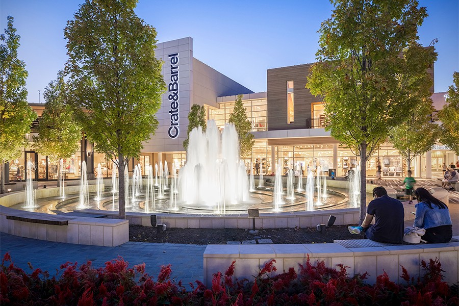 Outside of a Crate & Barrel at Oakbrook Center, a glowing fountain is a good resting spot for shoppers.